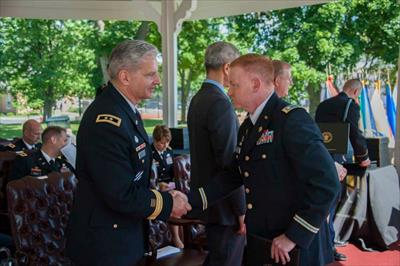 Lieutenant Colonel Peter Whalen (right) is congratulated by Major General Anthony Cucolo III, the 49th Commandant of the United States Army War College on his graduation from the War College.